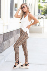 Model wearing the Snakeskin Microsuede Pants with fitted black top Side View