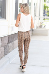 Model wearing the Snakeskin Microsuede Pants with fitted black top Back View
