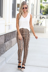 Model wearing the Snakeskin Microsuede Pants with fitted black top and heels from Dress Up