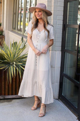 Model wearing the Taupe Ruffle Hem Maxi Dress with wide brim fedora