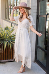 Model wearing the Taupe Ruffle Hem Maxi Dress with wide brim fedora from Dress Up