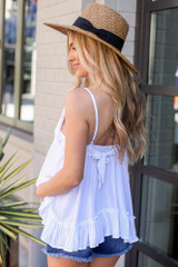 Model wearing the Lace Tie-Back Tank in White with wide brim fedora hat Back View