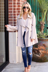 Dress Up model wearing the Lightweight Trench Coat with distressed dark wash jeans