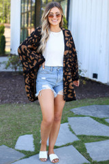 Model wearing the Luxe Knit Leopard Ruffle Cardigan with high rise distressed jeans and white tank from Dress Up Front View