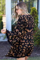 Model wearing the Luxe Knit Leopard Ruffle Cardigan with wide brim fedora from Dress Up