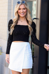 Model wearing the White Envelope Skirt with cute black crop top with polarized aviator sunglasses from Dress Up