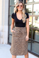 Model wearing the Leopard Midi Skirt with black bodysuit and polarized aviator sunglasses from Dress Up