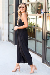 Model wearing the Wide Leg Jumpsuit with polarized aviator sunglasses from Dress Up Side View