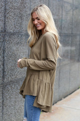 Model wearing the Oversized Tiered Back Top in Olive Side View
