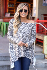 Model wearing the Leopard Print Oversized Top in Ivory with high rise mom jeans