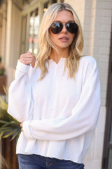Model wearing the Ribbed Knit Oversized Top in White