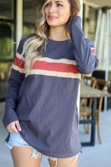 Model wearing the Oversized Striped Tee in Charcoal with high rise jeans from Dress Up