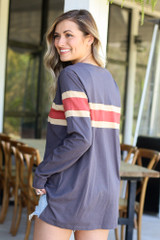 Model wearing the Oversized Striped Tee in Charcoal with high rise jeans from Dress Up Back View