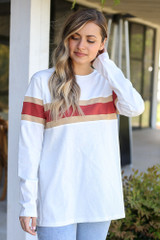 Model wearing the Oversized Striped Tee in White from Dress Up with high rise jeans