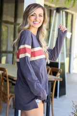 Model wearing the Oversized Striped Tee in Charcoal with high rise jeans from Dress Up Side View