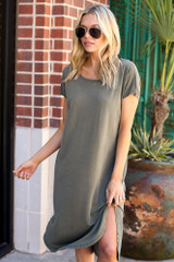 Model wearing the Jersey Knit Midi Dress in Olive with black sunglasses
