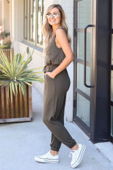 Model wearing the Jersey Knit Jumpsuit in Olive Side View