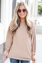 Model wearing the Oversized Brushed Knit Top in Taupe with high rise jeans Front View