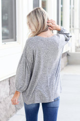 Model wearing the Oversized Brushed Knit Top in Grey Back View