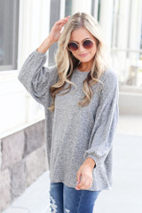 Model wearing the Oversized Brushed Knit Top in Grey  with polarized aviator sunglasses Front View