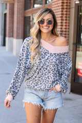 Dress Up model wearing the Leopard Brushed Knit Oversized Top with denim shorts
