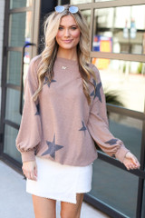 Model wearing the Star Brushed Knit Top with envelope skirt from Dress Up