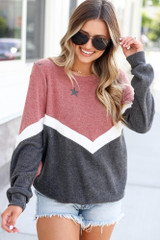 Model wearing the Star Color Block Pullover in Red