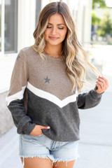 Model wearing the Star Color Block Pullover in Taupe with high rise mom jeans and polarized aviator sunglasses