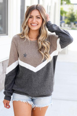Model wearing the Star Color Block Pullover in Taupe with high rise jeans and polarized aviator sunglasses Front View