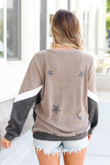 Model wearing the Star Color Block Pullover in Taupe with high rise jeans and polarized aviator sunglasses Back View