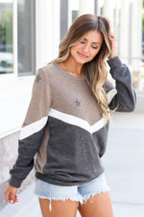 Model wearing the Star Color Block Pullover in Taupe with high rise jeans and polarized aviator sunglasses Side View
