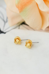 Flat Lay of the Knotted Stud Earrings