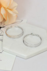 Silver - Flat Lay of the Layered Hoop Earrings