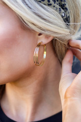 Dress Up model wearing the Layered Hoop Earrings in Gold