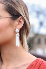 White - Dress Up model wearing the Beaded Tassel Earrings