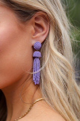 Close Up of the Beaded Tassel Earrings in Purple
