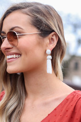 Close Up of the Beaded Tassel Earrings in White