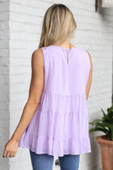 Model wearing the Tiered Swiss Dot Tank Top in Lavender Back view