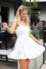 Model wearing the Crochet Trim Belted Babydoll Dress moving side view