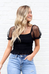 Model wearing the Puff Sleeve Smocked Crop Top with high rise mom shorts from Dress Up