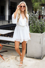 Model wearing the Gathered Sleeve Swiss Dot Romper with cute sunglasses and espadrille sandals
