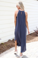 Model wearing the High Neck Maxi Dress in Charcoal with sneakers