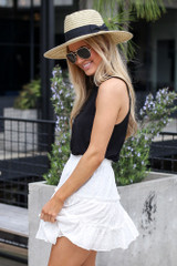 Model wearing the Eyelet Tiered Skirt in white with black tank top Side View