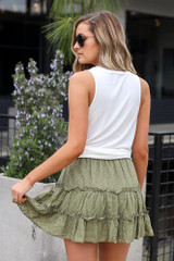Model wearing the Eyelet Tiered Skirt in Olive with white tank top Back View