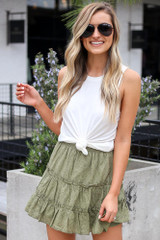 Model wearing the Eyelet Tiered Skirt in Olive with white tank top front view