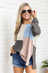Blush - Model wearing the Color Block Lightweight Knit Top in Blush with high rise denim shorts and polarized aviator sunglasses from trendy online boutique