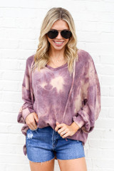 Model wearing the Tie-Dye Oversized Pullover Hoodie with high rise mom shorts from online dress boutique