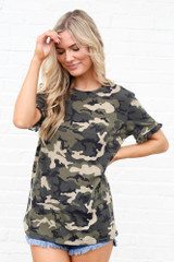 Model wearing the Camo Ruffle Sleeve Tee with denim shorts