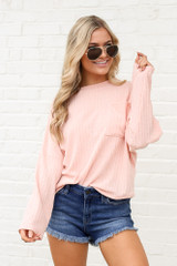 Model wearing the Lightweight Ribbed Knit Oversized Top in Peach
