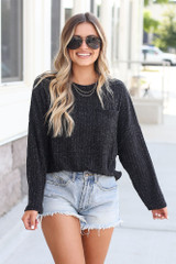Black - Model wearing the Lightweight Ribbed Knit Oversized Top with denim shorts